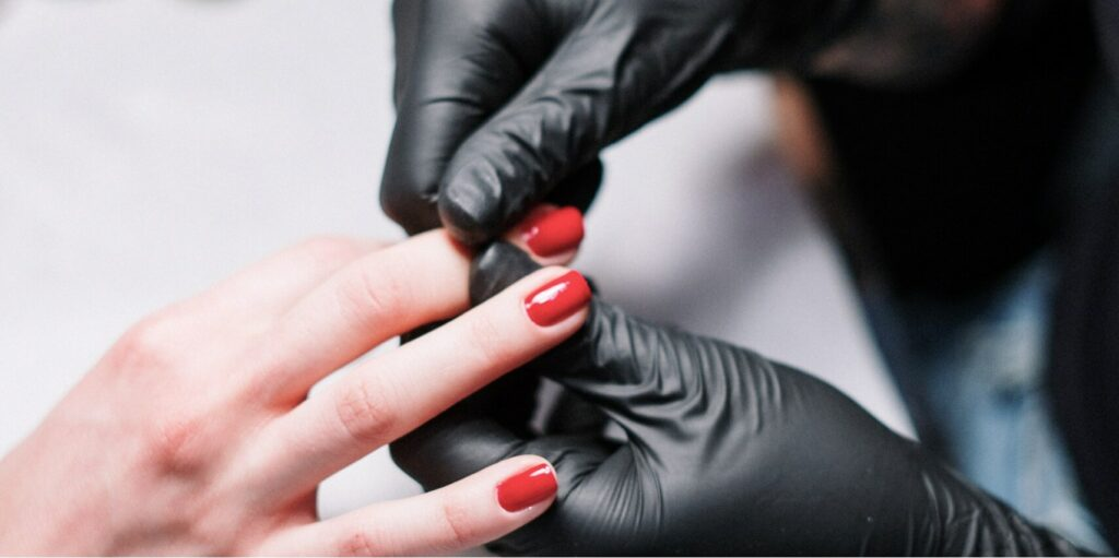 person in black gloves massaging fingers 3997383@1.5x